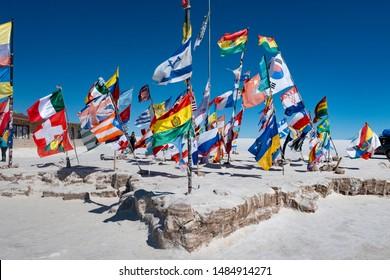 Uyuni, Bolivia - July 30, 2019: Flags from Dakar Bolivia travel in the desert