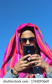 UYUNI, BOLIVIA - May 01, 2019: woman using a cellphone during the day