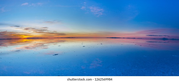 Uyuni reflections. One of the most amazing things that a photographer can see. Here we can see how the sunrise over an infinite horizon with the Uyuni salt flats making a wonderful mirror to infinity