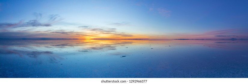 Uyuni reflections. One of the most amazing things that a photographer can see. A sunrise over infinity, the infinite horizon cover by water offer us awe colorful sky symmetric reflections on water