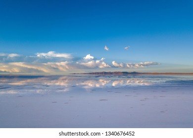 Uyuni Salt Flat  Lake in Summer is Covered with Water. Potosi, Bolivia. Aerial Drone Scene at Sunset