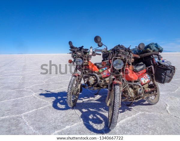 Uyuni, Uyuni/Bolivia - April 22 2017 - Two overland motorcycles parked on the world famous Salar De Uyuni salt flats of Bolivia