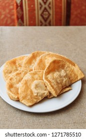 Uzbek eastern Tatar cuisine, cheburek with meat and suluguni cheese and greens on . Cheburek - fried pie with meat and onions.