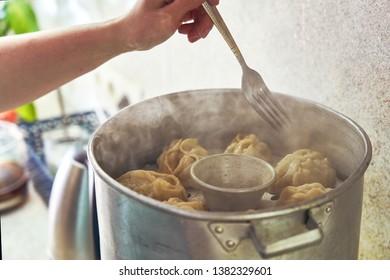 Uzbek national food manta, like dumplings, in a steamer, steamed food.