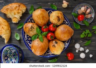 Uzbek national food - somsa, kurt, flapjack