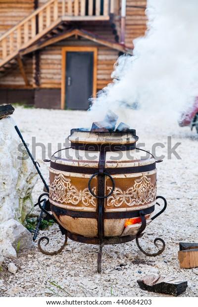 Uzbek tandoor for cooking fish meat