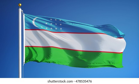 Uzbekistan flag waving against clean blue sky, close up, isolated with clipping path mask alpha channel transparency