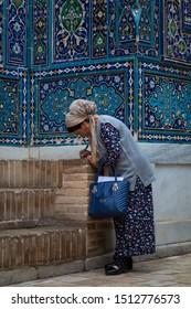 "Uzbekistan Samarkand- April 15,2019  Uzbek woman at Shah-i-Zinda (meaning ""The Living King"") is a necropolis in the north-eastern part of Samarkand"