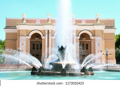 UZBEKISTAN, TASHKENT, JUNE 28, 2018:Fountain in the background of the building of the Navai Theater in Tashkent