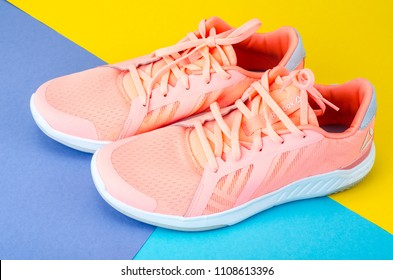 Uzbor'e, Belarus - June 4, 2018: Pair of sport pink shoes Reebok on colorful background.. Top view. The company was founded in 1958 in England. In 2005, Adidas acquired Reebok as a wholly owned subsid