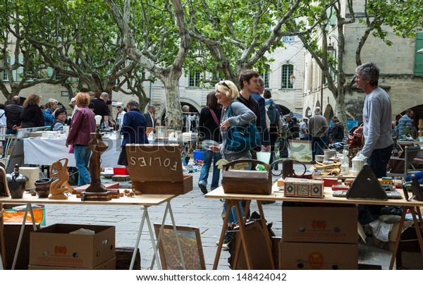 UZES, FRANCE - MAY 12: Unidentified people at a traditional flea market as seen on May 12, 2013 in Uzes, France. Flea markets are very popular type of entertainment in France.