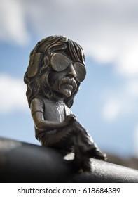 UZHGOROD, UKRAINE - Apr 08, 2017: Bronze miniature sculpture of musician Jon Lord on the embankment in the city of Uzhgorod, made by the sculptor Mykhailo Kolodko