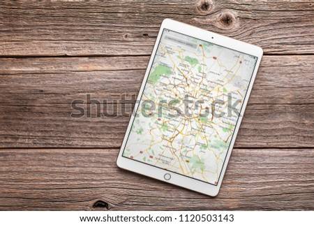 Uzhgorod, Ukraine - June 23, 2018: Ipad pro 10.5 inches with PARIS map on a wooden table.