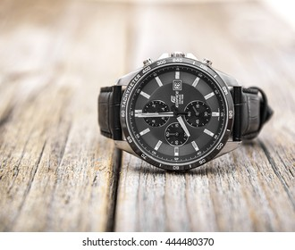 UZHGOROD, UKRAINE - JUNE 28, 2016: Modern Men's Watch CASIO EDIFICE with a leather strap, on a wooden background, on June 28, 2016 in Uzhgorod, Ukraine.