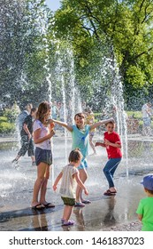 UZHGOROD, UKRAINE - May 28, 2017: Happy children playing in a water fountain in a hot day