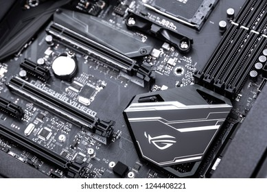 UZHGOROD, UKRAINE - October 24, 2018: Box of motherboard Asus Rog Crosshair vii Hero on white background. ROG - Republic of Gamers - gaming line of productive computer equipment from the company Asus.