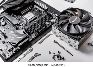 UZHGOROD, UKRAINE - October 25, 2018: Computer installation. Processor Ryzen 7 2700X against the background of a computer motherboard Asus rog crosshair vii hero, and cooler be quiet.