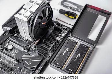 UZHGOROD, UKRAINE - October 25, 2018: Motherboard Asus Rog Crosshair vii Hero with installed cooler Be quiet, and RAM Kingston DDR4 HyperX Predator. Build a PC.