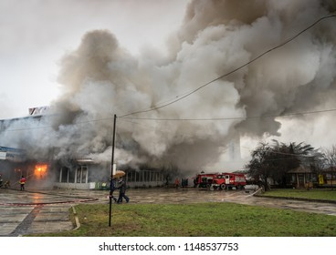 UZHHOROD, UKARINE - FEBRUARY 01, 2016: Fire in the central department store Ukraina in Uzhhorod, Ukraine. Fire and strong smoke covered building. Dangerous situation
