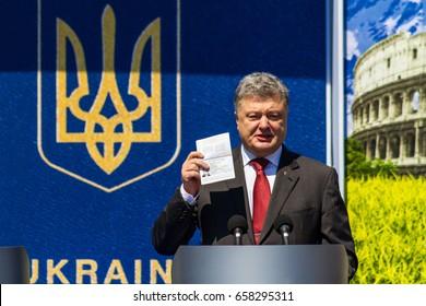 Uzhhorod, Ukraine - June 11, 2017: Ukrainian President Petro Poroshenko demonstrates his biometric passport during a symbolic ceremony on the occasion of the introduction of a visa-free regime for.