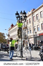 UZHHOROD, UKRAINE - OCTOBER 13, 2018: Installation of lights during the reconstruction of Petefi square in a sunny day in Uzhhorod, Ukraine