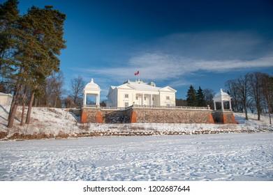 Uzutrakis manor estate in winter, Trakai, Vilnius, Lithuania, Europe. Uzutrakis manor ensemble was created in 1897-1902 by count Jozef Tyszkiewicz and his wife duchess Jadwiga Swietopulk-Czetwertynska