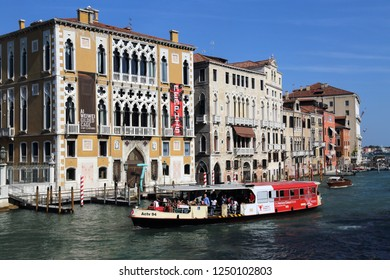 V: Ferry boat with passengers on the Grand Canal