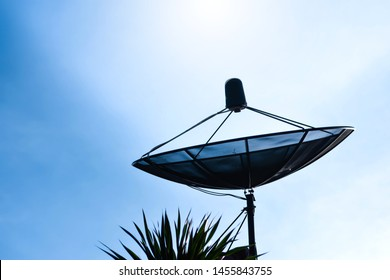 V receiver plate Satellite dish above the roof of the building, communication technology in the digital world