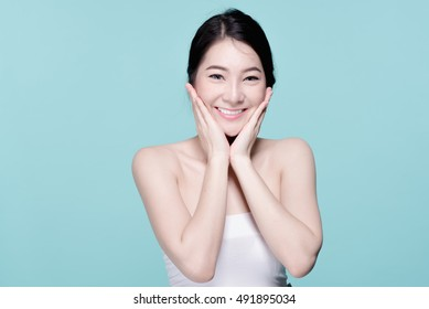 V Shape Face of Asian woman smiling and touching her face. Skincare and Cosmetology concept. blue background.