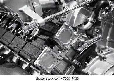 V12 car engine fragment, closeup photo with selective focus