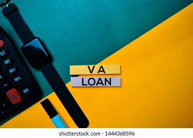 VA Loan text on top view color table background.