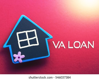 VA LOAN written on red background with wooden house