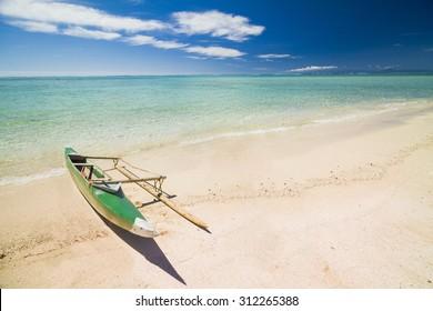 Va'a samoa canoe or a boat on the beach with clear sky
