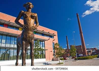 VAASA, FINLAND - AUGUST 5: Statue of a woman centaur in Vaasa with building of university campus on background, August 5, 2008 in Vaasa, Finland