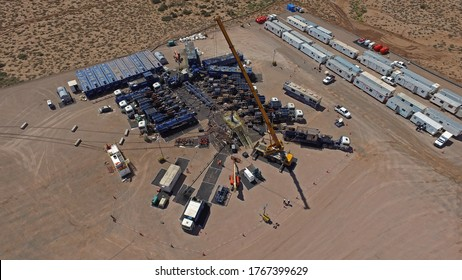 Vaca Muerta, Argentina, December 25, 2015: Extraction of unconventional oil. Battery of pumping trucks for hydraulic fracturing (Fracking).