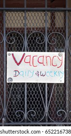 VACANCY sign with 3-D glasses color potential.