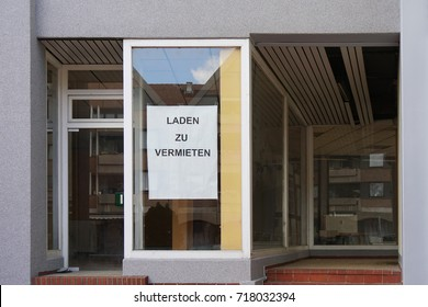 vacancy sign in shop window, German sign reads: store for rent