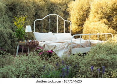 Vacancy white retro bed and pillows in the garden processed in soft vintage tone