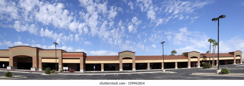 Vacant business offices and shopping mall with empty parking lot for rent