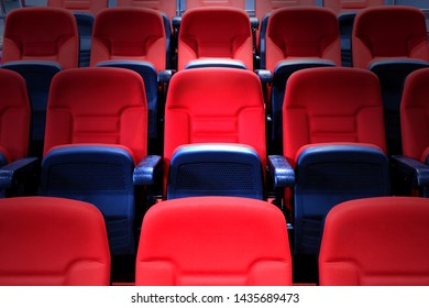 The vacant chairs in the movie theater with spotlight.