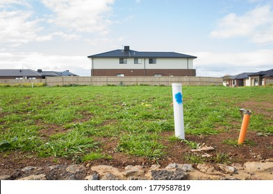 Vacant land next to some residential suburban houses. Concept of real estate development, land for sale and a new suburb, Tarneit, Melbourne, VIC Australia.