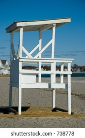 Vacant lifeguard station on a sandy shoreline beach.