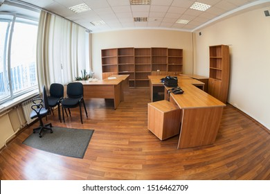 Vacant office with furniture or abandoned office space with no people, wide angle view