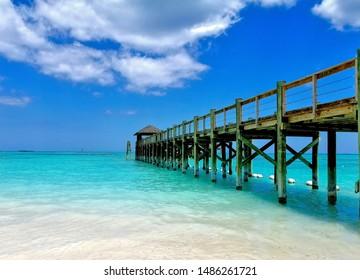 vacant rustic wooden pier in Caribbean ocean
