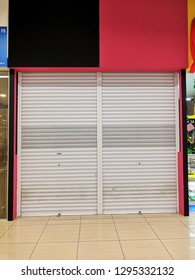 Vacant shop closed with roller shutter waiting to rent out