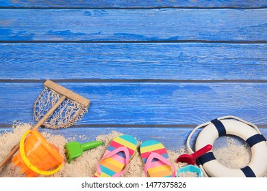 Vacation background with beach sand and blue wood