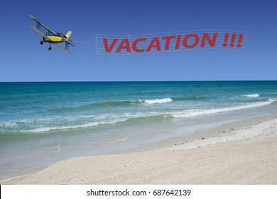 Vacation banner at a beautiful beach pulled by a plane.