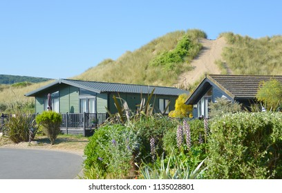 Vacation chalets with sand dunes in the background