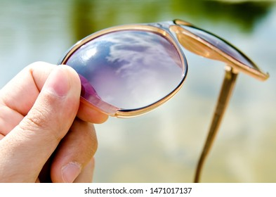 vacation concept of hand with glasses