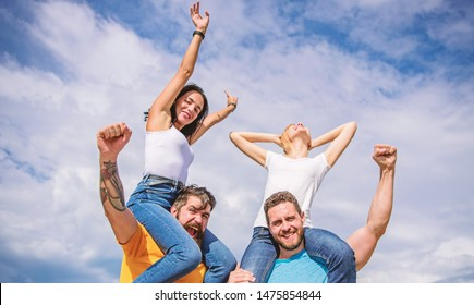 Vacation and hobby. Visit famous festival during vacation. Rock music festival. Feel freedom. Dancing couples. Friends having fun summer open air festival. Men and women enjoy music festival.
